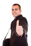 Young businessman with thumb up. Young attractive businessman standing in black suit holding thumb up Stock Images