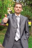 Young businessman with thumb up Stock Photography