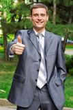 Young businessman with thumb up Royalty Free Stock Image