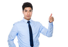 Young businessman with thumb up gesture Stock Photo