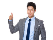 Young businessman with thumb up gesture Royalty Free Stock Image