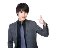 Young businessman with thumb up gesture Stock Images