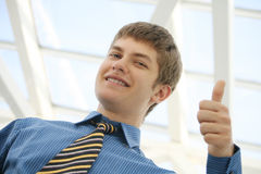 Young businessman thumbs up Stock Image