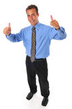 Young businessman with thums up gesture Royalty Free Stock Image