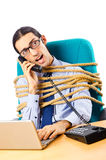 Young businessman tied with rope Stock Photo