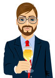 Young businessman toasting with a glass of champagne Stock Image