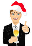 Young businessman toasting with a glass of champagne Royalty Free Stock Photo