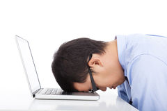 Young businessman too overwork to asleep royalty free stock photography