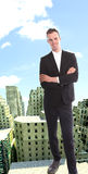 Young businessman on top of rendered building Royalty Free Stock Photo
