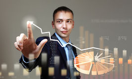 Young businessman touching icon Stock Photography
