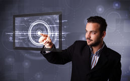Young businessman touching modern technology tablet Royalty Free Stock Photo