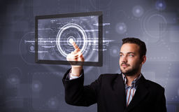 Young businessman touching modern technology tablet Stock Photos