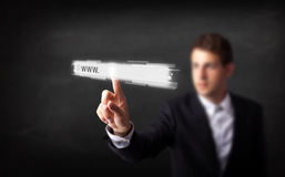 Young businessman touching web browser address bar with www sign. Young man touching web browser address bar with www sign royalty free stock photos