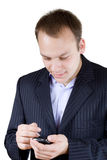 Young businessman with a touchscreen phone Royalty Free Stock Photos