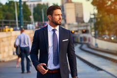 Young businessman in the tram stop Stock Images