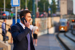 Young businessman in the tram stop Stock Image