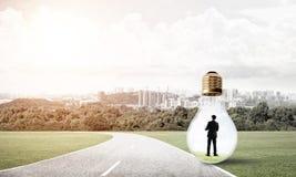 Businessman inside light bulb Royalty Free Stock Photo