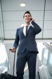 Young businessman traveling with bag and phone Royalty Free Stock Images