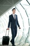 Young businessman traveling with bag Stock Photos
