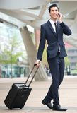Young businessman traveling with phone and bag Stock Images