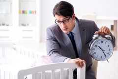 Young businessman trying to work from home caring after newborn Royalty Free Stock Photos