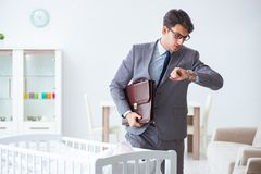 The young businessman trying to work from home caring after newborn baby. Young businessman trying to work from home caring after newborn baby Royalty Free Stock Photo