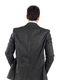 Young businessman turning his back to camera royalty free stock photography