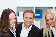 Young businessman with two female coworkers Stock Photos