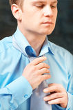 Young Businessman Tying A Tie Stock Image