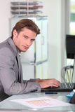Young businessman typing Stock Images