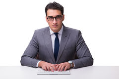 Young businessman typing on a keyboard isolated on white backgro Royalty Free Stock Photo