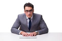 Young businessman typing on a keyboard isolated on white backgro Stock Photography
