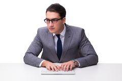Young businessman typing on a keyboard isolated on white backgro Royalty Free Stock Images