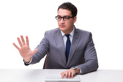 Young businessman typing on a keyboard pressing virtual buttons Royalty Free Stock Photo