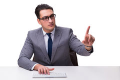 Young businessman typing on a keyboard pressing virtual buttons Stock Photo