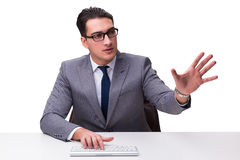 Young businessman typing on a keyboard pressing virtual buttons Royalty Free Stock Image