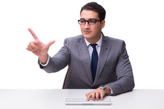 Young businessman typing on a keyboard pressing virtual buttons Stock Images