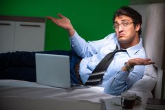 The young businessman under stress in the bedroom at night royalty free stock photography