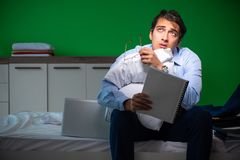 Young businessman under stress in the bedroom at night royalty free stock photo