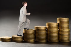 Young  businessman upstairs career from money Stock Photos