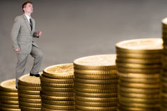 Young businessman upstairs career from money. Young businessman upstairs career Royalty Free Stock Image