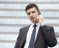 Young businessman in an urban setting Stock Photography