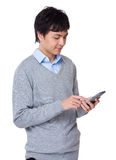Young businessman use of the cellphone Royalty Free Stock Images