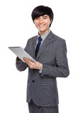 Young businessman use digital tablet Stock Photo