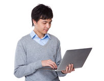 Young businessman use of the laptop computer Stock Photos