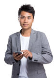 Young businessman use of mobile phone Stock Photography