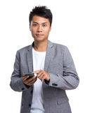 Young businessman use of the mobile phone. On white background stock image