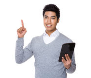 Young businessman use of the tablet and finger point up Stock Photo