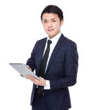 Young businessman use of tablet pc Stock Photos