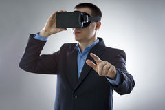 Young businessman uses a virtual reality glasses Royalty Free Stock Images